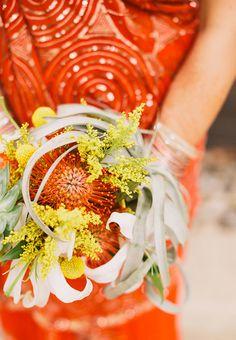 A vibrant succulent and protea bouquet | Brides.com