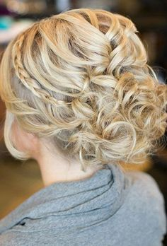Brides: A Curly Updo With a Thin Braided Band. Adorning your classic curled updo with a thin braid adds a glamorous touch.