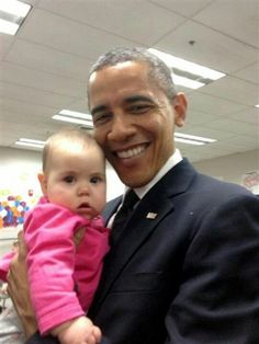 President Obama and young friend.