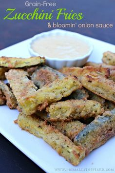 Zucchini fries get a healthy, grain-free makeover and boy are they delicious! Pair this with the bloomin' onion sauce and you've got a super tasty treat!