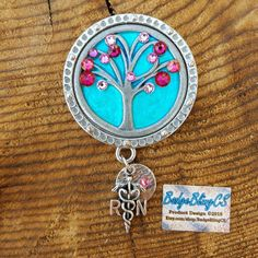 Mothers wear brooches ans work badges! Mothers day gift of pink flowers, tree of life brooch This piece is stunning in person! The swarovski crystals are absolutely memorizing ❤ This would make a fantastic gift. Add charms to customize!