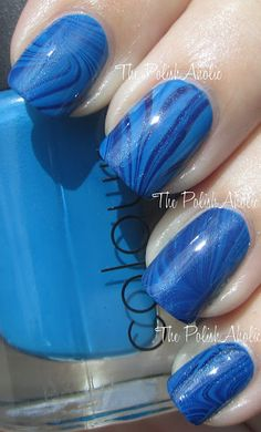 Base is CND Anchor Blue and the marbling is with CND Anchor Blue and Jessica Midnight Moonlight
