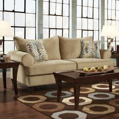 Cozy has never been so stylish. Get comfy on a beige sofa with 2 colorful accent throw pillows. (Matching Loveseat also available.) Frickle Sofa | Weekends Only Furniture and Mattress