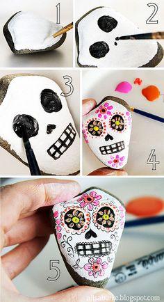 Sugar skulls to make next year -- using rocks!  This artist is so creative!