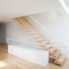 Portuguese firm A+R Arquitectos is the company behind this floating wooden staircase.