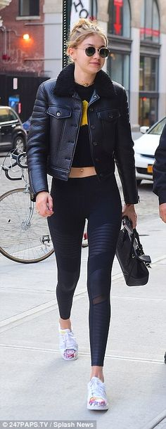 Fantastic figure: Gigi, 21, led the casual charge, donning a leather bomber jacket with very flattering spandex athletic leggings and a short t-shirt that showed just a glimpse of her taut tummy