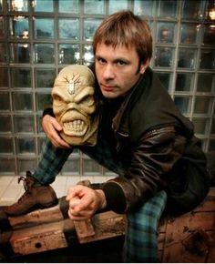 Bruce Dickinson holding Eddie