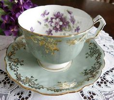 Pale green teacup with violets