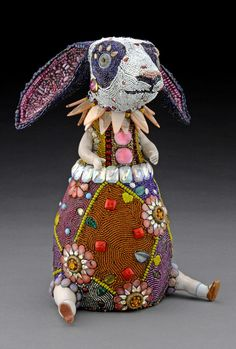 Besty Youngquist builds wonderful anthropomorphic sculptures with contemporary and antique beads from around the world and vintage porcelain doll parts and prosthetic glass eyes. All her things are extra unusual and unique. Must see!