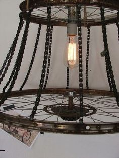 I want to ride my bicycle or at least have a cool Bicycle Chandelier made from repurposed bike parts by a Texas artist. part Bicycle Chandelier