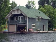 The Boathouse: a new definition to lakefront living! Lakefront Property, Metal Siding, Boat Lift, Water House, Cool Boats, Garage House, Sitting Area, Rustic Design, The Great Outdoors