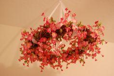 flower wreath mobile in the nursery <3