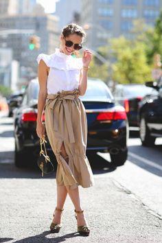 Stephanie Hill wears  H&M top, Storets skirt, Ralph Lauren shoes