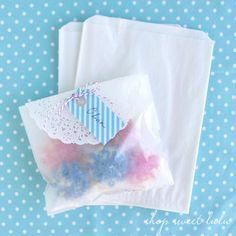 love the glassine bags with doily