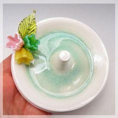 Pastel flowers Wedding ring holder $40. from elisethomasdesigns.com