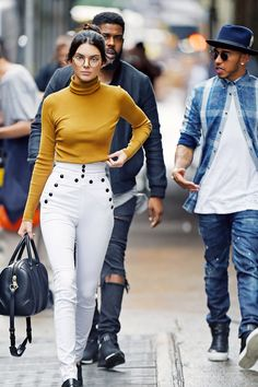 Kendall Jenner & Lewis Hamilton fuel those dating rumours. Kendall Jenner looked awesome in a pair of Isabel Marant trousers, geek-chic glasses, a Givenchy handbag, black loafers and a tight turtleneck.