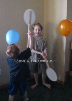 Balloon Tennis! I used paint stirrers, balloons, paper plates and tape. This kept the boys busy for such a long while batting the balloons all over the living room, up in the air and back and forth to each other.