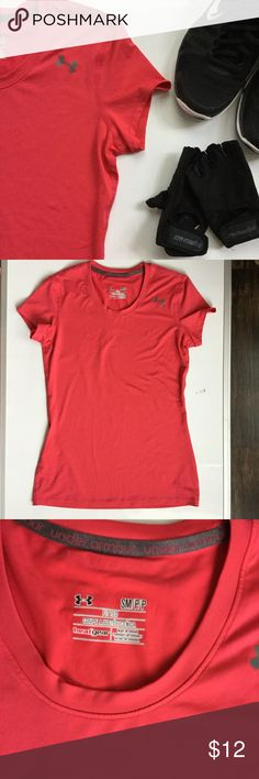 UA Heat Gear Fitted Tee NWOT. Great for work-outs in the heat! It is made of 90% polyester and 10% elastase. It looks red in the photos, but it is actually a dark pink. Selling b/c I have too many work-out shirts. Under Armour Tops Tees - Short Sleeve