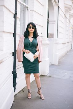 """We've always appreciated a little ruching. Blogger @Chevronseclairs  gives us her styling tips. on the blog: """" The blush pink cardigan softens the bold army green colour while the scalloped pouch adds a cute finishing touch."""" Day-to-event dressing done."""