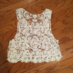 Crochet Crop Top Only worn a couple of times, great condition! No stains or tears. Size medium. Looks great with a summer tan ☺️☀️ Vivid Collection NY Tops Crop Tops