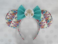 Its a Small World themed Mouse Ears - my unique original design! My ears are stuffed, but lightweight & sewn onto the headband.  - comfort headband