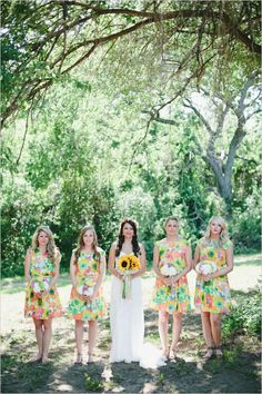 Fun, bright floral dresses for the bridesmaids, plus sunflowers for the bride #wedding #gardenparty #gardenwedding #flowers #dress