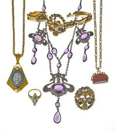 An art nouveau amethyst and silver swag necklace together with a collection of enamel, hardstone, onyx, garnet and 14k gold jewelry