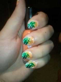 Palm trees in a Sunset. Easy to do. Uses blue, orange, green, black and white. Pain your nails white. Let dry. Pat on blue on the botton of your nails with a sponge. I used a makeup sponge. Then sponge on orange on the top. Let dry. Take a black tip nail polish and draw a short line and then a long line. Last Use a thin green nail polish to draw the tops of the trees. Apply a clear coat and your done :)