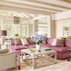Cream paneled wals make a large family room feel more intimate. | Photo: @maxkimbee, Design: Amanda Nisbet