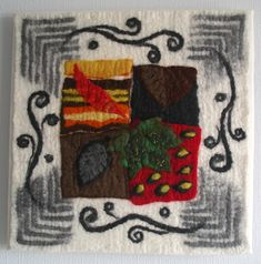 'Autumn Leaves' - hand-made prefelts, some slashed, laid onto monochrome background before fulling.