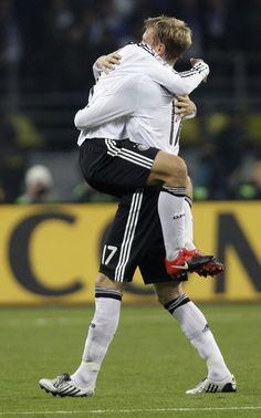 Miroslav Klose getting carried away by Per Mertesacker