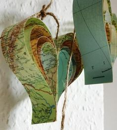 hearts from old maps -- these would make really cute xmas decorations.