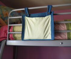 This loft bed organizer is great for holding books, reading glasses, and other small items when your ready for bed. When your done reading, just put the book in the pocket hanging on the side of the bed and go to sleep. It doesn't clutter up things either!