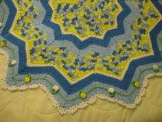 French Country round ripple afghan, free pattern plus a link to basic tutorial for round ripples.  This one has pretty edging & a cute flowered vine embellishment.  Would make a nice pillow, too.   . . . .   ღTrish W ~ http://www.pinterest.com/trishw/  . . . .   #crochet #blanket #throw