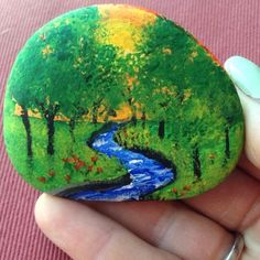 This BEAUTIFUL Hand Painted Planter Stone, pictures a peaceful forest scene cut by a meandering brook at sunset. A perfect touch to any planterBeautiful & Unique Rock Painting Ideas , Let's Make Your Own CreativityArts And Crafts Paper Refferal: 311706611 Rock Painting Patterns, Rock Painting Ideas Easy, Rock Painting Designs, Paint Ideas, Pebble Painting, Pebble Art, Stone Painting, Shell Painting, Painted Rocks Craft
