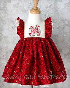 This one of a kind dress is a stunning choice for the holidays! Features a hand embroidered bodice with the word Noel in a Victorian style and...