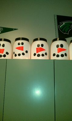 Snowman using plastic tubs from protein powder, and ducktape face!