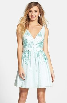 Free shipping and returns on Hailey by Adrianna Papell Bow Detail Matte Sequin Fit & Flare Dress at Nordstrom.com. Frosty matte sequins swirl across a buoyant lace dress cut with an elegant double V-neckline and finished with a pretty grosgrain bow.