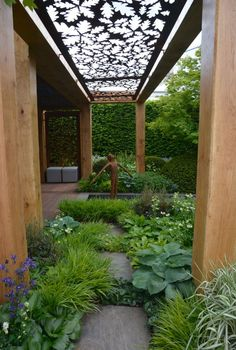 The Morgan Stanley Garden for Great Ormond Street Hospital by Chris Beardshaw.  A rich, green and verdant woodland scheme, sprinkled with pockets of colourful planting, bursting through the tree canopy and perennial understory. Marvelous! Gold medal winner.