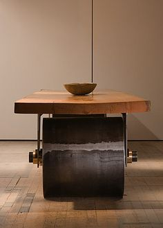 """Rolling Table, Artist's Studio, Designed by Tom Kundig of Olson Kundig Architects, the Rolling Table has steel wheels, axles and forks. The wheel bearings are bronze and the table top is a single slab of Douglas Fir. The top measures 24 feet long by 4 feet wide by 4"""" thick. The Steel drum wheels are 30"""" diameter by 30"""" wide."""