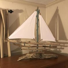 A beautiful sailboat built out of locally found driftwood along the Chester River in Maryland.