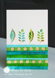"""Some fiddling on the kitchen table: """"I glued scraps or handmade paper and tissue paper to the bottom of the card. For a watercolor look I loaded the stamps with Distress Ink and sprayed water on top before stamping."""""""
