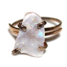 This sparkling statement ring is totally gorgeous with a blue, green and purple hued Australian opal with flashes of rainbow fire. A natural tumbled Australian opal adorns a rose gold vermeil prong ring. This ring is adjustable and best for sizes 5 - 8.5 . Fabulous!  xoxoxo payton  For more cool jewelry looks, check out http://www.etsy.com/shop/FizzCandy  All FizzCandy creations come beautifully wrapped in a colorful canvas bag which is tied with a bright ribbon.