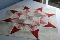 star with 9-patch center...the color choices make this beautiful