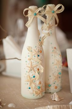 50 Inspiring Centrepieces; paint glass bottles and decorate them with shells