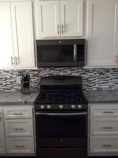 Gray and white kitchen, slate appliance, gray granite.