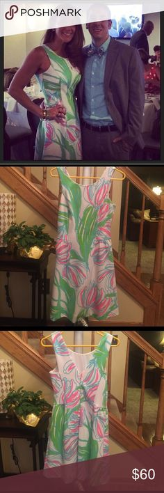 Lilly Pulitzer small dress Show stopper! Wore once and got at least 10 compliments on this dress! Perfect with any color neon heels (have size 8 Kate spade licorice pink pumps that match perfectly, contact if interested). Never goes out of style! Lilly Pulitzer Dresses Midi