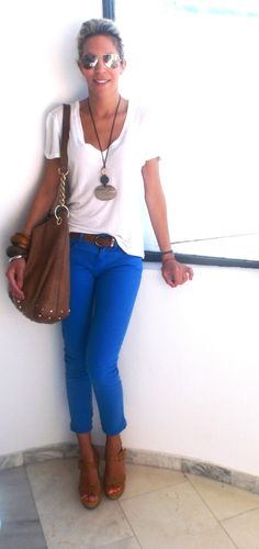 Cobalt blue skinny jeans, white vneck, brown purse, brown belt, brown heels, brown bracelets, ray bans