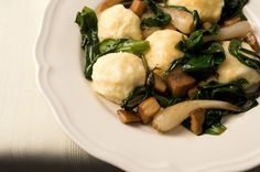 Ricotta gnudi with wild ramps and porcini mushrooms. Recipe on http://honest-food.net