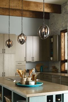 Add personality to your kitchen island with circular pendants. Beatify your home with new lighting ideas and styles.